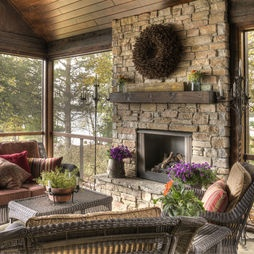 Screened porch with stone fireplace to stay warm and cozy on those cool nights.
