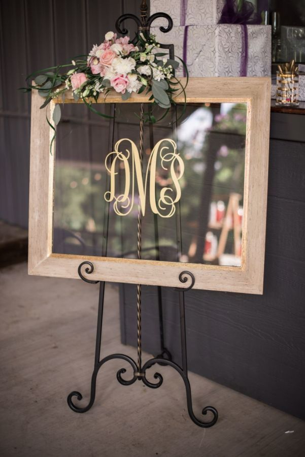 Modern rustic gold monogrammed acrylic framed wedding sign: http://www.stylemepretty.com/little-black-book-blog/2016/09/09/sparkly-southern-rustic-elegant-wedding/ Photography: Olivia Lott - http://www.olivialott.com/