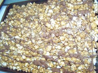 Disneyland's caramel popcorn with chocolate drizzled on top! So good, but cheaper to make at home!  I gave bags of this to neighbors for Christmas last year.