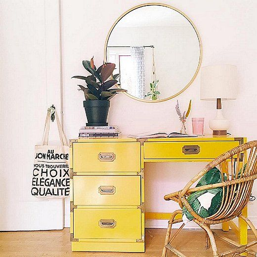 Love the pairing of the banana yellow campaign-style desk with the wicker chair and banana leaf print pillow!