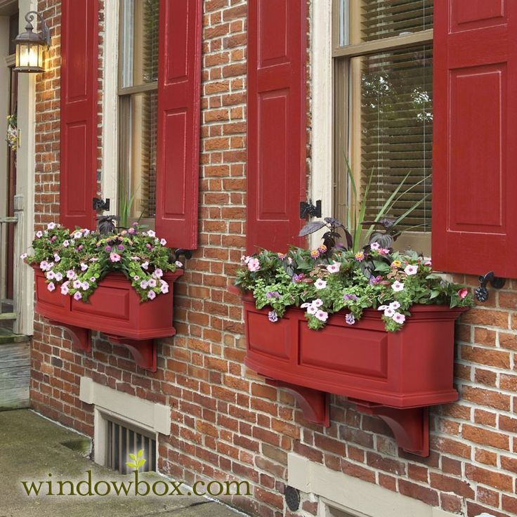Red window boxes and shutters, brick walls but I want lighter brick