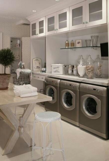 Oh my GOD. Dream laundry room! Not sure what I'd need 3 machines for, but the rest is divine.