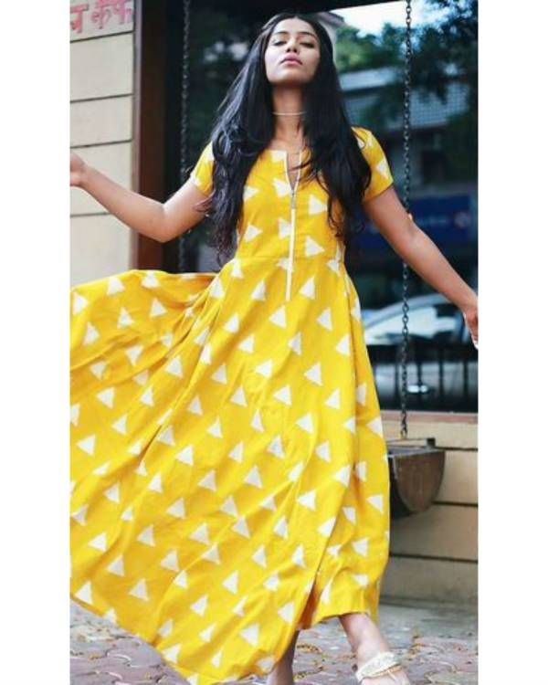 Amber zip dress    Bring in some sunshine in your wardrobe this winter, with this amber yellow dress. It comes with a zipper in front and block prints in off white. It is a long dress with an asymmetrical hemline.