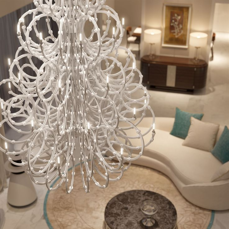 Inspired by a female body shape and covered in thousands of flowers, the Venus chandelier emits a feminine glow. Designed by Rony Plesl. #lighting #interior #design #collections #plesl #craftsmanship #bohemian #glass #history #mariatheresa #chandelier