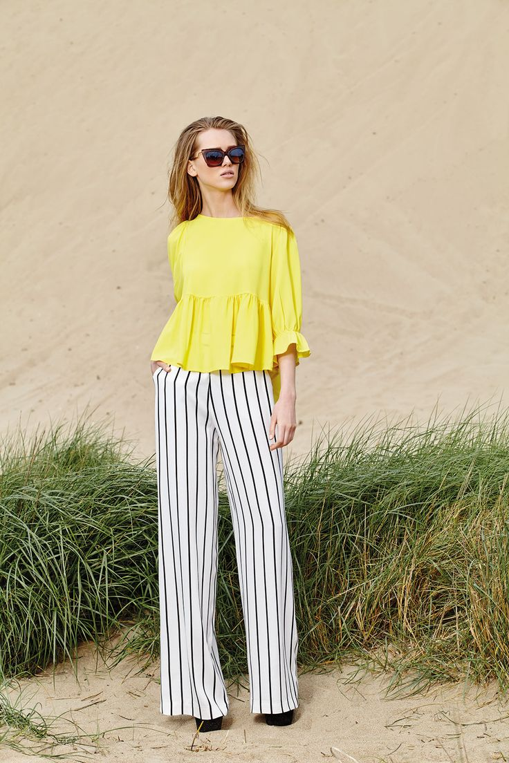 Black and white stripes meet intense color shades to bring your outfit to new hights!