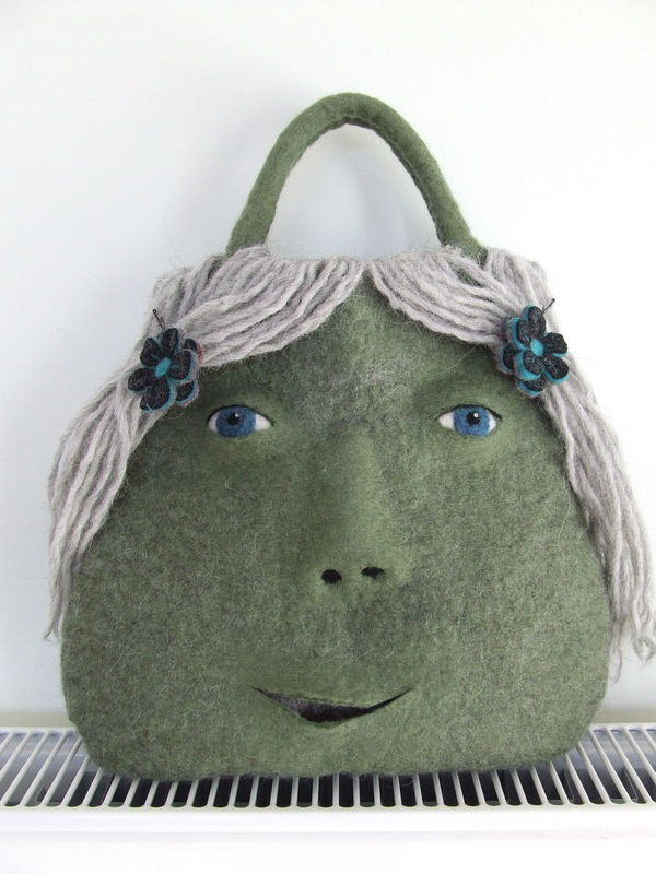 Catherine Felted Monster Bag Here's another felted monster bag, she's called Catherine. Don't be fooled by the grey hair, she's still very young and quite an athlete.