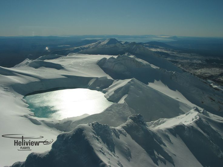 Looking North over Mt Ruapehu's Crater Lake with Lake Taupo in the distance.