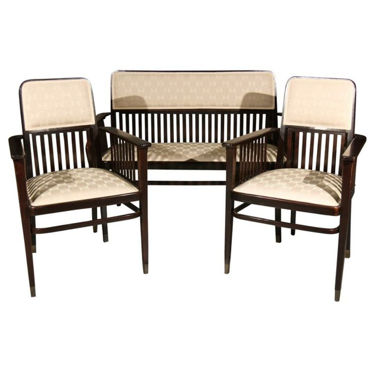 """Viennese salon suite in ebonized beachwood by Marcel Kammerer upholstered period style fabric. The slat back ornamentation and capped brass feet were typical of the Vienna Secessionist movement. Kammerer, a well known Austrian furniture designer, designed for Thonet among others. CIRCA DATA: 1905 DIMENSIONS: 37.25 """" h x 48.5 settee 23.75 chair"""" w x 23"""" d PRICE: $6,900"""