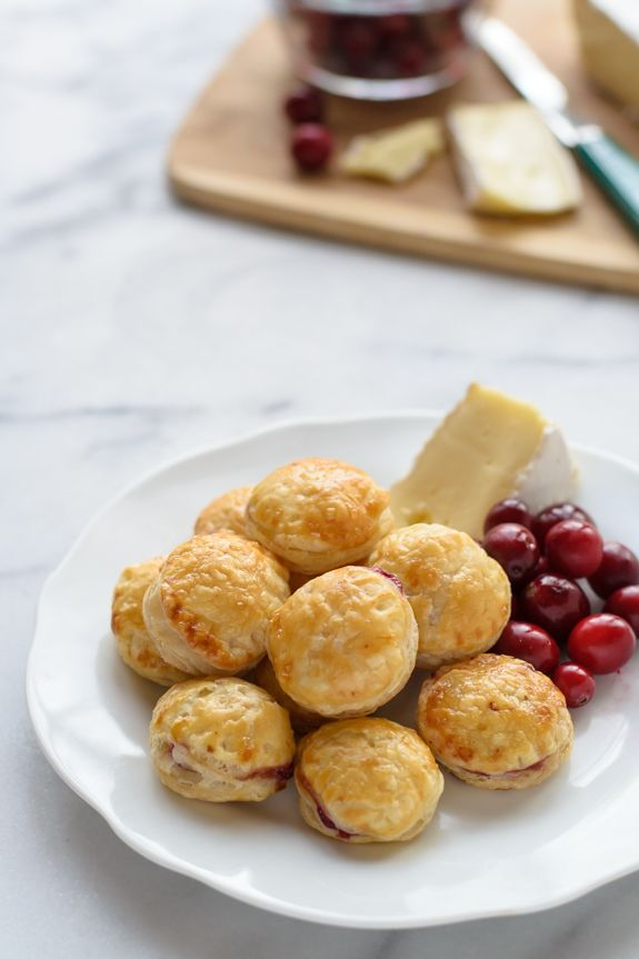 The perfect make-ahead puff pastry appetizer: Puff pastry cut into rounds, filled with cranberry and Brie cheese, then baked. Each like a mini baked Brie!