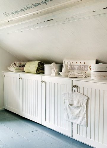 """Idea for """"Built-ins """" along slanted ceilings in laundry room"""