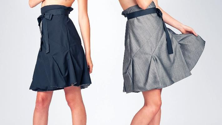 Can you believe that she's wearing the same skirt on both images? The two sided JOLIER Lily skirt now available in vibrant grey combined with casual black ! Get it online! -Click!: http://jolier.mycashflow.fi/product/122/lily---xs-xl-double-side-wrap-skirt!  Jolier Lily black-teal. Double side wrap skirt with black ribbon belt. By simply turning the skirt inside out you can change the colour from office to party from casual to outstanding! www.jolier.com