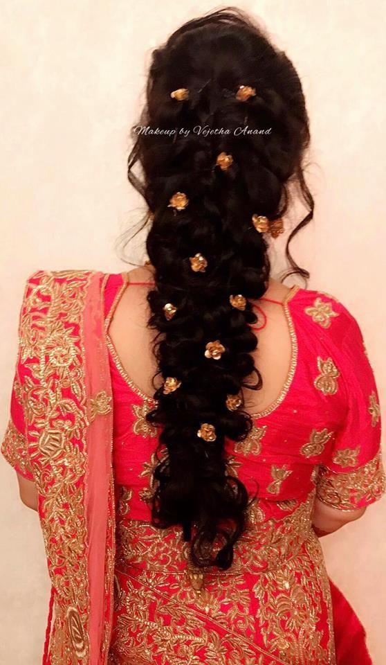 Gorgeous bridal hairstyle with flowers. Loose fishtail braid. Hair accessories. Bridal lehenga. Tamil bride. Telugu bride. Kannada bride. Hindu bride. Malayalee bride. Find us at https://www.facebook.com/SwankStudioBangalore