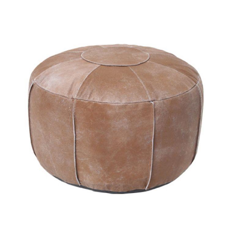 Puf de piel en color marrón desgastado. Aspecto artesanal y elegante de la firma HK Living. Medidas: Ø50x30 cm