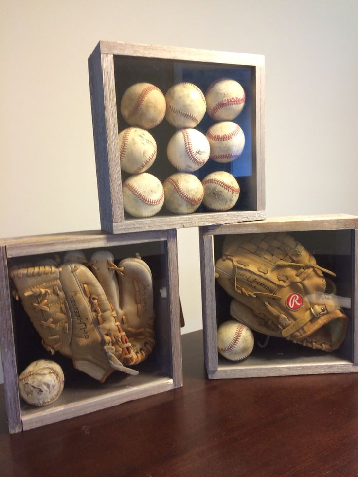 Designed for a sports themed room. Very simple shadow boxes. I found used baseballs and kids sized gloves and put them in a standard sized shadow box.