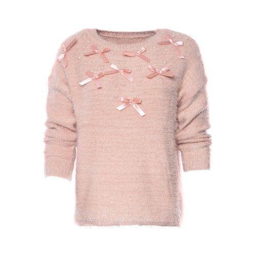 Roze korte pluizige trui, versierd met satijnen strikjes. Taille Unique.