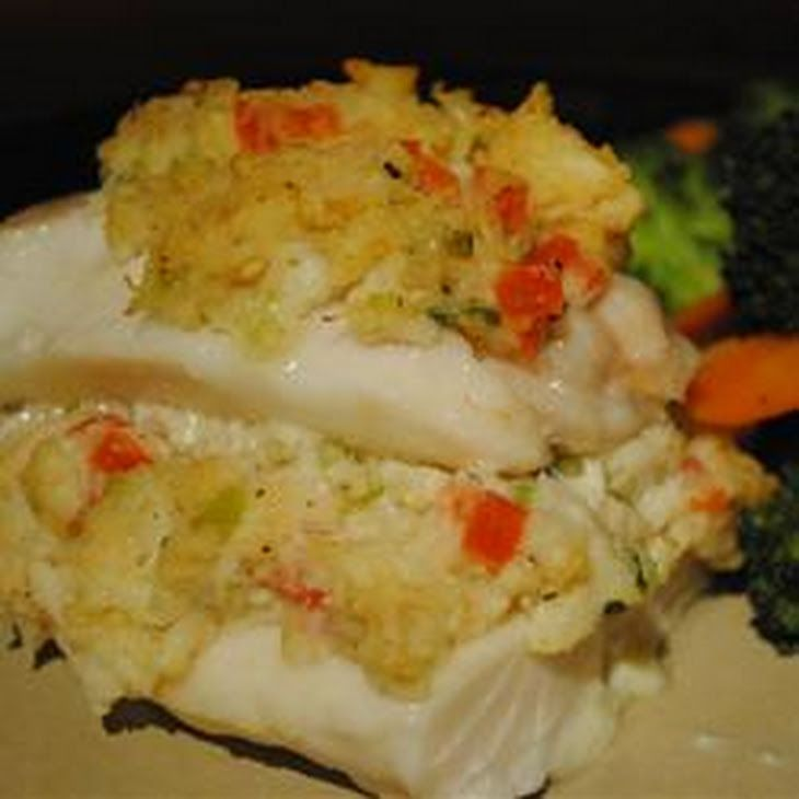 Crab Stuffed Haddock Recipe Main Dishes with olive oil, celery, green onions, minced garlic, lump crab meat, white bread, salt, ground black pepper, eggs, romano cheese, lemon juice, tomatoes, ground black pepper, butter, haddock fillets