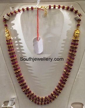 22 carat gold ruby beads necklace with three strings of ruby beads attached to Lakshmi motifs on either side. For price inquiries contact: dharmesh25@yahoo.com Related PostsRuby Beads NecklaceLight Weight Ruby South Sea Pearl NecklaceAntique Necklace With Elephant PendantRuby Beads and South Sea Pearls NecklaceRuby Strings Mala and Lord Ganesh NecklaceKajal Aggarwal Mother in Ruby Strings