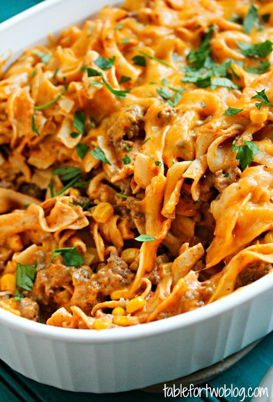 Creamy Enchilada Pasta Casserole: Ingredients: 1 pound ground beef 1/2 tsp. chili powder 1/4 tsp. cumin 1/4 tsp. cayenne pepper 5 ounces cream cheese 1/4 cup light sour cream 1 can (10 oz.) enchilada sauce  1 cup shredded sharp cheddar cheese 1 cup shredded monterey jack cheese 1 cup frozen corn kernels, thawed 1 can (4 oz.) diced green chiles 12 ounces egg noodles Salt & pepper