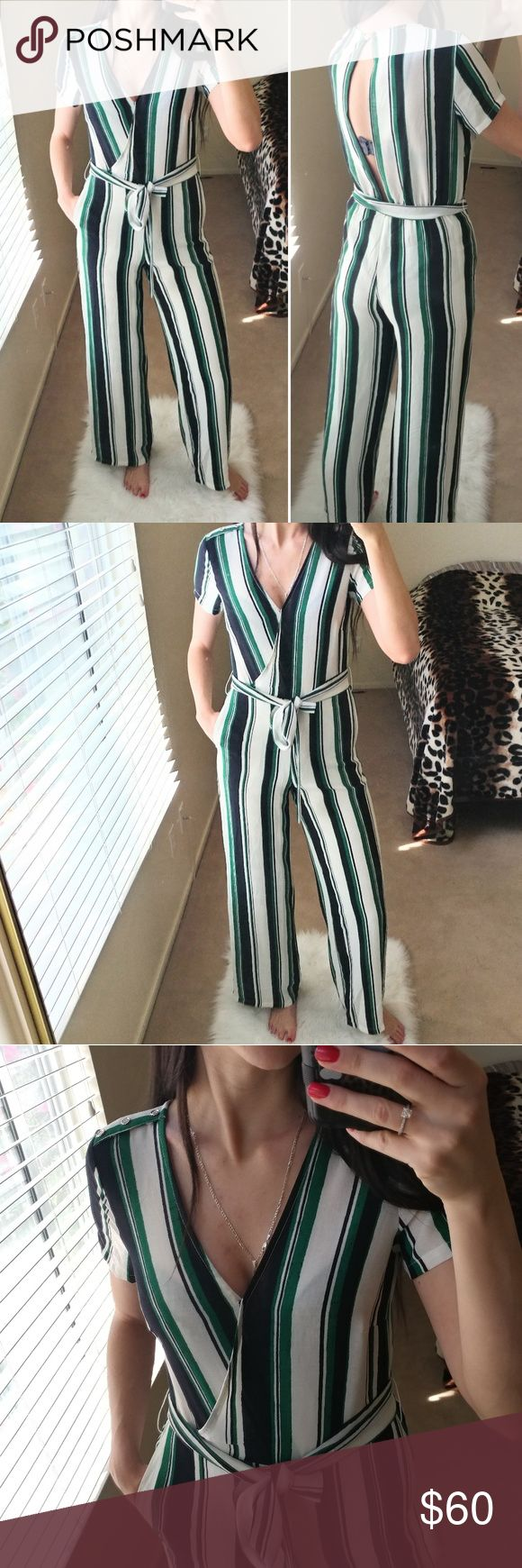 """Lucy Paris stripped jumpsuit Short sleeve Open back  Black, white and green stripes  Condition: new with tags Size: XS Measures:  Bust flat 19"""" Shoulders 16.5""""  Inseam 31.25"""" Length 58"""" Waist flat 13"""" (stretchy)   100% polyester Lucy Paris Pants Jumpsuits & Rompers"""