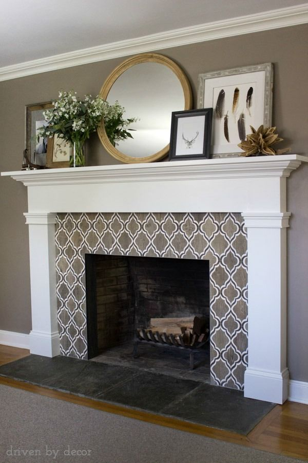 Stunning fireplace tile! Also love the large round mirror and layered artwork