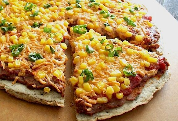 Layer on the Southwestern flavors in this playful vegan Mexican pizza. It starts with refried beans, followed by salsa, corn and nondairy cheese.