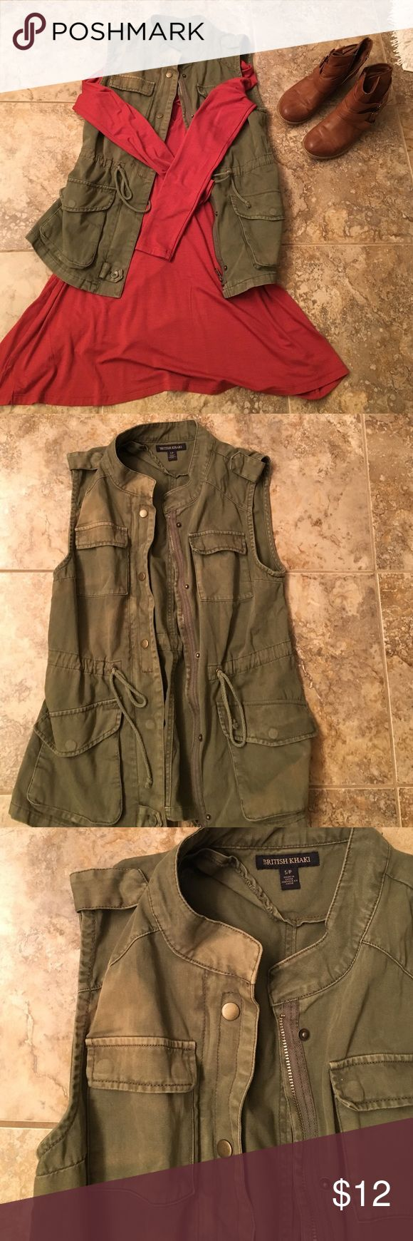 Green utility vest Army inspired utility vest. Falls below the hip. Cute with a dress and booties as pictured or with leggings. Some slight discoloration at the collar--although the vest was worn only a handful of times British Khaki Jackets & Coats Vests
