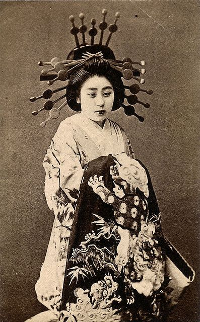 """ The Oiran type of high-class prostitutes lived in the brothels and entertainment districts (""Pleasure Quarters"") of big cities like Yoshiwara in Edo (now Tokyo), Shimabara in Kyoto, the Shimmachi in Osaka and Maruyama in Nagasaki. To entertain their clients, oiran practiced the arts of dance, music, poetry and calligraphy, and an educated wit was considered essential to sophisticated conversation."" S)"