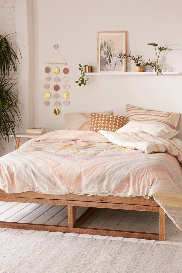 Bedroom with pink bedding from Urban Outfitters
