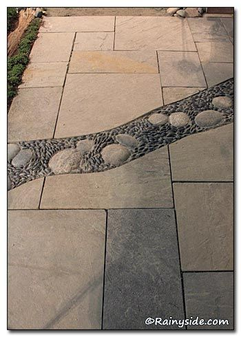 ...a river of mosaic stone that broke up the expanse of flagstone in front of the building.