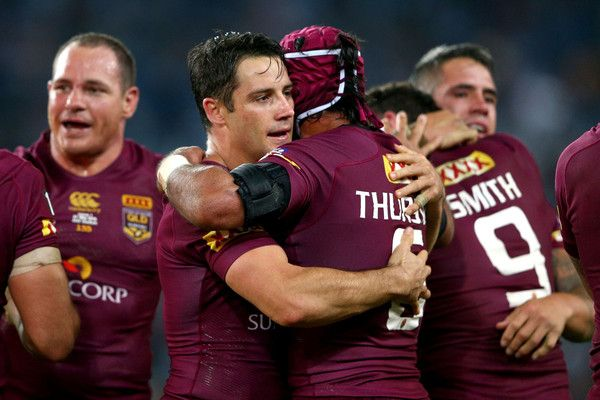 """Messrs. COOPER CRONK and JOHNATHAN THURSTON (both of """"The Maroons"""") celebrate winning game one of the State of Origin series between the New South Wales Blues and the Queensland Maroons at ANZ Stadium on May 27, 2015 in Sydney, Australia."""