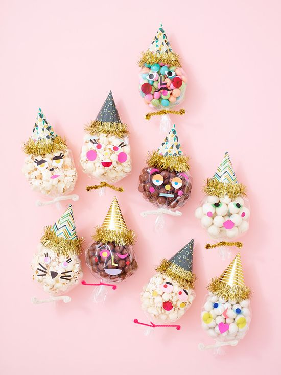 DIY Party People Favors - fill little cello bags with a little bit of candy, add little stickers and top with little tinsel party hats