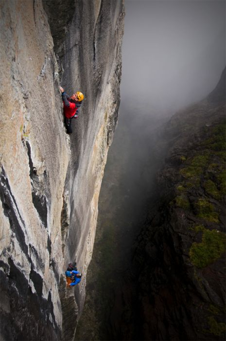 Alex and Marc climbing on one of their sailing expeditions! Photographer = Jimmy Chin