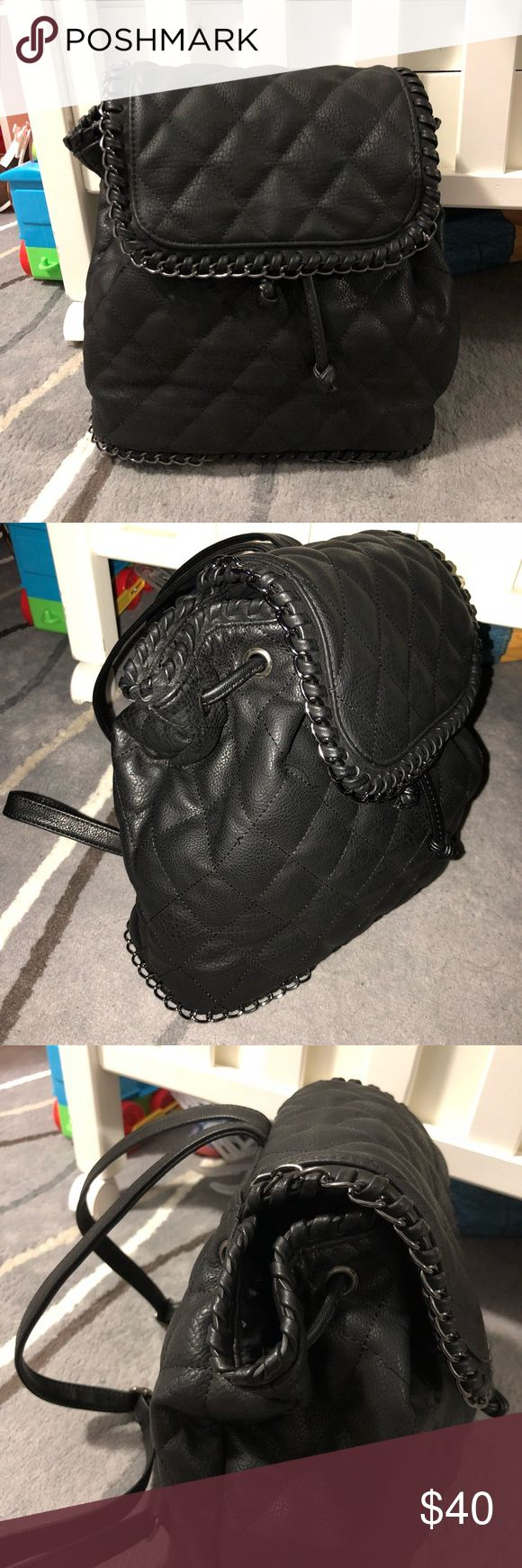 BASICALLY NEW QUILTED BACKPACK SAKS FIFTH AVENUE QUILTED BACK PACK / USED ONLY ONCE / SUPER SUPER CUTE / NEW CONDITION / NO FLAWS / CUTE CHAIN DETAIL ON BOTTOM AND ON CLOSE FLAP / I️ ACCEPT 🅿️🅿️ and Ⓜ️! Saks Fifth Avenue Bags Backpacks