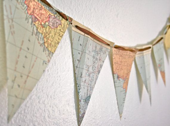 Map your love of adventure! Super easy to make...cut a map into triangles (or any shape you choose), punch a hole in two of the corners and string ribbon or rope through. Voila! Great way to display maps from your off-campus studies!