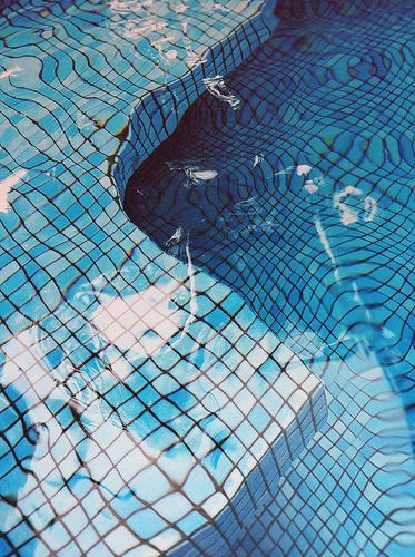 A tiled pool - very 80's. Would love to jump into this - the period and the pool, right about now.