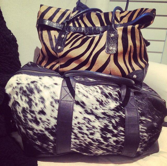 We love our cowhide... #leather #black #cowhide #travel #bag #wanderlust #love #black #white #tiger #heaven #follow #wow #popular #girl www.charliemac.com.au