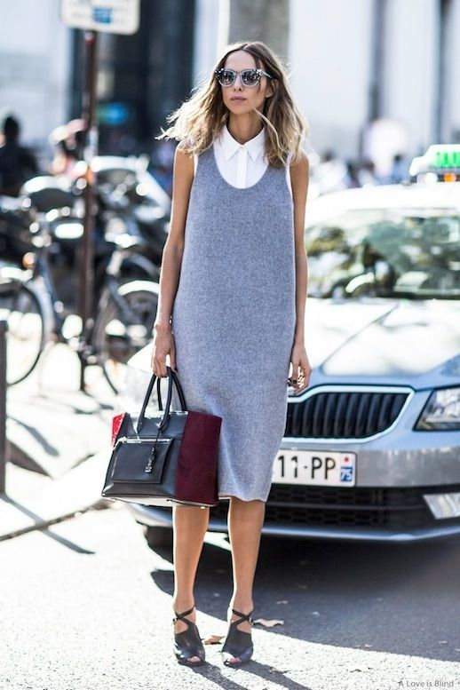Chic and professional workwear is definitely not the easiest thing to come by. Thankfully, we stumbled upon Candela Novembre's street style look for stylish office inspiration. We are major fans of how she neatly layers a sleeveless grey dress over a sleeveless white button-down shirt and completes the polished work look with a tote bag and strappy heels.