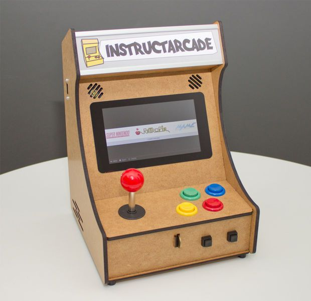 A handmade bar-top mini arcade with controls for one player. Controlled with a Raspberry Pi!