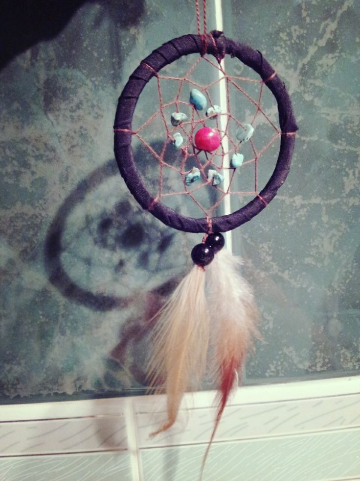 Dreamcatcher hanger made from curtain ribbon band , turquoise stones .wooden red bead ,black bead and feathers :)
