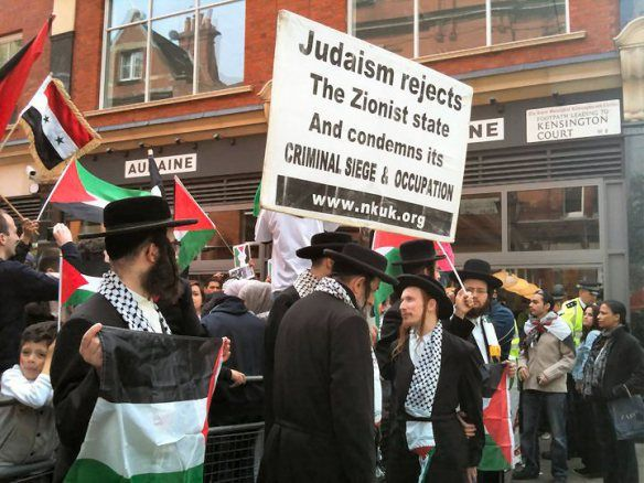 Ultra-Orthodox Jews stand in Solidarity with the Palestinians at a rally in London.