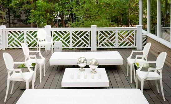 Railing - A truly stunning deck patio by Martensen Jones Interiors with white Chinese Chippendale railing, a white Chinese garden stool, and white Kartell Louis ghost chairs