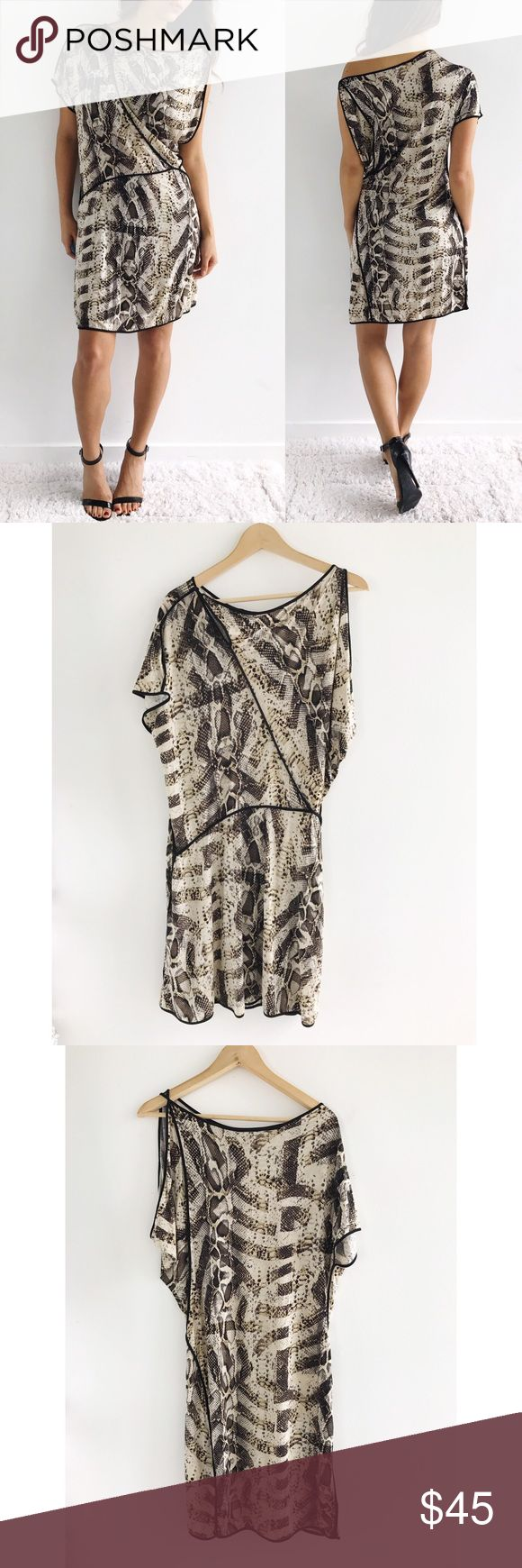 "BCBGMAXAZRIA Snake Print Dress BCBGMAXAZRIA Snake Print Dress! Excellent condition. Relaxed fit. Pull over. Super stretchy. Rayon, spandex blend. Button detail on neckline. Snake print. draped sleeves. Chest-36"" waist-30"" hips-38"" length-35.5"" size small. (Model size 4) BCBG Dresses Midi"