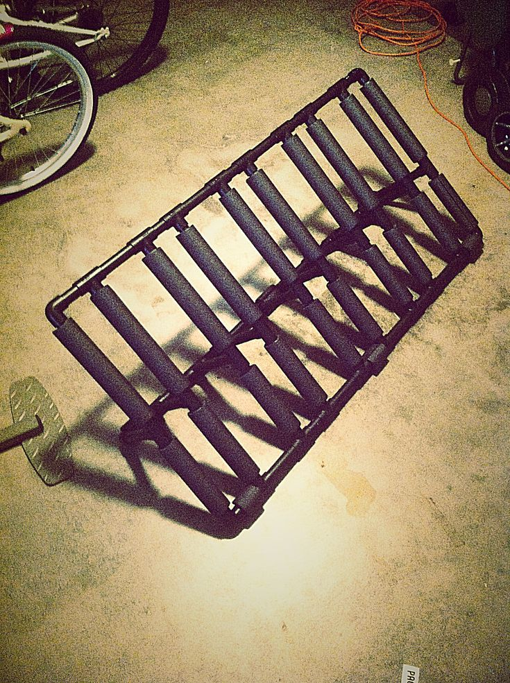 My DIY bike rack made all from PVC and painted with black textures truck bed liner paint... Holds 5 bikes