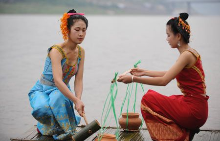 204) Flowing through Yunnan's southern valleys and fertile lowland valleys is the home of the Dai, 'The People of the Water' http://en.wikipedia.org/wiki/Xishuangbanna_Dai_Autonomous_Prefecture