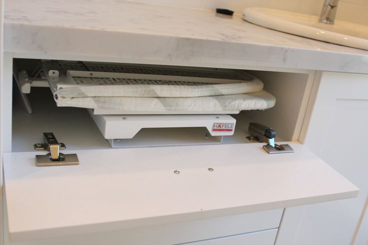Fold Away/ Pull out ironing board. unfolds and rotates 180 ...
