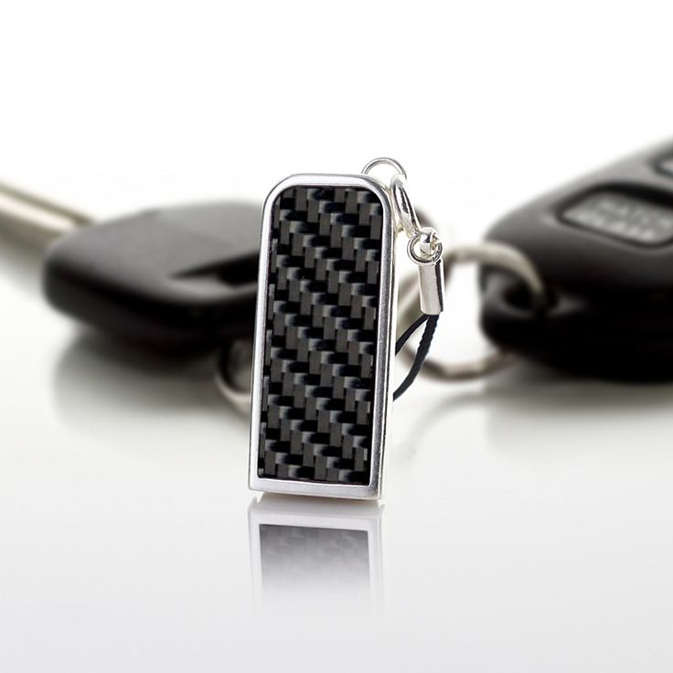 ZaNa Mobile Flash Carbon is a very neat stick specifically designed as a pendant to your mobile phone. The metal casing of this little miracle is covered with a layer of pure silver, 999 fineness Complementing the unique design are used inserts with carbon fiber
