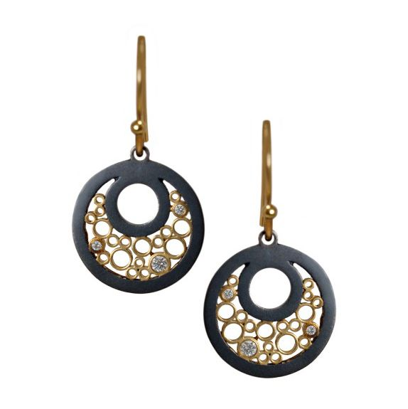 """""""The circle symbolizes flow, completion, cycle, and most importantly – harmony."""" Symbolic circles of oxidized sterling silver dance around open lines. Yellow gold ear wires add the perfect subtle contrast. – 18 karat yellow gold – oxidized sterling silver – .10 cttw diamonds – 1 1/4″: length – 3/4″: width measurements are approximate SKU: 24531 …"""
