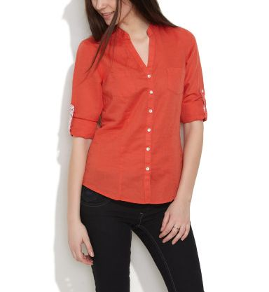 Give yourself a ruched twist with this solid colored shirt. Its smart  collar and button