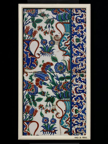 Panel of two border tiles of glazed grey fritware, painted in colours on a white slip, Iznik, second half of 16th century