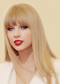 Taylor Swift. Love the red lips and the rest natural except for a little black ont he eyes for quite not so loud cat eyes